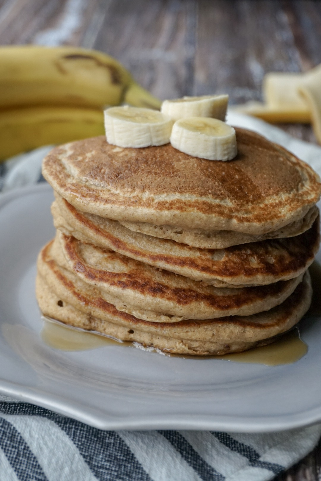 Stack of Banana Oatmeal Blender Pancakes with toppings